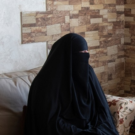 Sandy Sulzle sits in her apartment in Amman, Jordan.