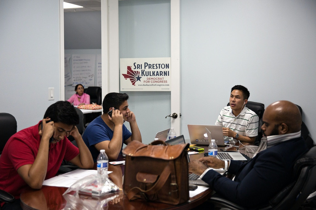 Campaign volunteers of Sri Preston Kulkarni phone bank voters to discuss their voting plans at the Sri Preston Kulkarni campaign office in Sugar Land, Texas on May 8, 2018.