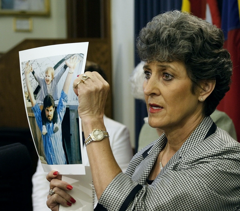 "** ADVANCE FOR SUNDAY SEPT. 27 ** FILE - In this Tuesday, May 2, 2006  file photo, Judy Cavnar, of Ardmore, Okla., a cousin of executed Texas prison inmate Cameron Todd Willingham, displays a picture of him during a news conference in Austin, Texas. Willingham always maintained he was innocent of setting the fire that killed his three small children two days before Christmas in 1991, and even the prosecutor who put him away now admits the arson investigation was ""undeniably flawed."" Says Innocence Project director Barry Scheck of Willingham: ""There can no longer be any doubt that an innocent person has been executed  (AP Photo/Harry Cabluck, file)"