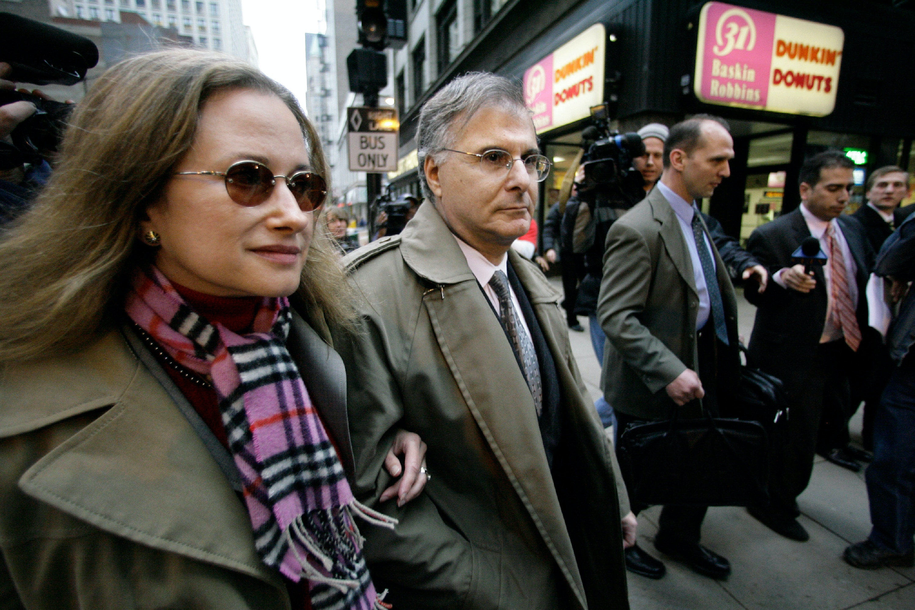 Millionaire campaign contributor Stuart Levine, center, who has become an issue in the Illinois governor's race, leaves federal court Friday, Oct. 27, 2006, in Chicago. The businessman who funneled thousands of dollars into Gov. Rod Blagojevich's campaign pleaded guilty Friday to using his seats on two state boards in a bid to collect millions of dollars in kickbacks. (AP Photo/M. Spencer Green)