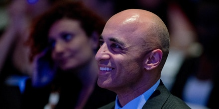Yousef Al Otaiba, the Ambassador of the United Arab Emirates to the United States of America reacts as he is acknowledged by Former President Bill Clinton as he gives the opening address to kick off a meeting of International Aid Groups at the InterAction Forum 2017 at the Washington Convention Center, Tuesday, June 20, 2017, in Washington. (AP Photo/Andrew Harnik)