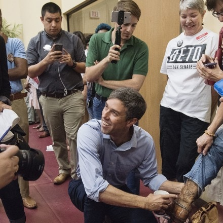 Beto O'Rourke, D-El Paso, points to his autograph on the boot of Staci Oller Smith of Tyler during his campaign stop at St. Louis Baptist Church in Tyler, Texas on Monday Aug. 13, 2018. O'Rourke signed the boot over a year ago at a campaign stop at Don Juan's Restaurant in downtown Tyler. The current U.S. Rep is running for U.S. Senate against Ted Cruz. More than 600 people attended the campaign stop. (Sarah A. Miller/Tyler Morning Telegraph via AP)