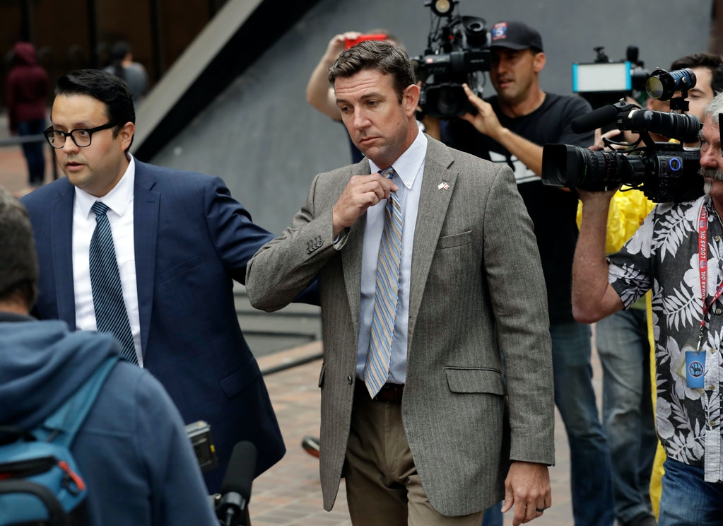 U.S. Rep. Duncan Hunter, center, leaves court Monday, Sept. 24, 2018, in San Diego. Hunter and his wife Margaret pleaded not guilty on Aug. 23 to charges they illegally used his campaign account for personal expenses. (AP Photo/Gregory Bull)