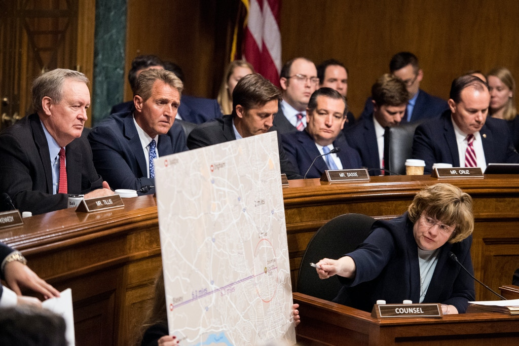 Phoenix prosecutor Rachel Mitchell, points to a map as she questions to Christine Blasey Ford at the Senate Judiciary Committee hearing, Thursday, Sept. 27, 2018 on Capitol Hill in Washington. Senators from left, Sen. Mike Crapo, R-Idaho, Sen. Jeff Flake, R-Ariz., Sen. Ben Sasse, R-Neb., Sen. Ted Cruz, R-Texas, Sen. Mike Lee, R-Utah. (Tom Williams/Pool Image via AP)