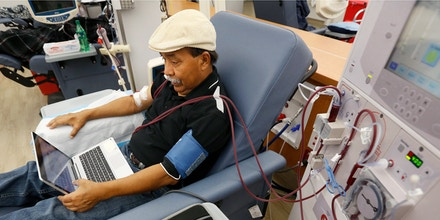 In this photo taken Monday, Sept. 24, 2018, Adrian Perez undergoes dialysis at a DaVita Kidney Care clinic in Sacramento, Calif. If approved by voters in November, Proposition 8, would limit dialysis clinics' profits. (AP Photo/Rich Pedroncelli)