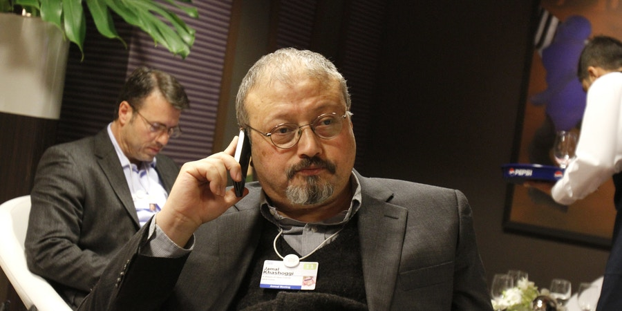 FILE - In this Jan. 29, 2011, file photo, Saudi Arabian journalist Jamal Khashoggi speaks on his cellphone at the World Economic Forum in Davos, Switzerland. The Washington Post said Wednesday, Oct. 3, 2018, it was concerned for the safety of Khashoggi, a columnist for the newspaper, after he apparently went missing after going to the Saudi Consulate in Istanbul. (AP Photo/Virginia Mayo, File)
