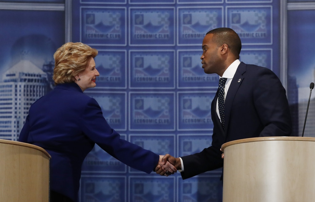 Sen. Debbie Stabenow, D-Mich., left,and challenger John James shake hands after their debate at the Detroit Economic Club, Monday, Oct. 15, 2018, in Detroit. Stabenow is seeking a fourth term and has led comfortably in polls, and James, a business executive and combat veteran, participated in their second debate before the November election. (AP Photo/Carlos Osorio)