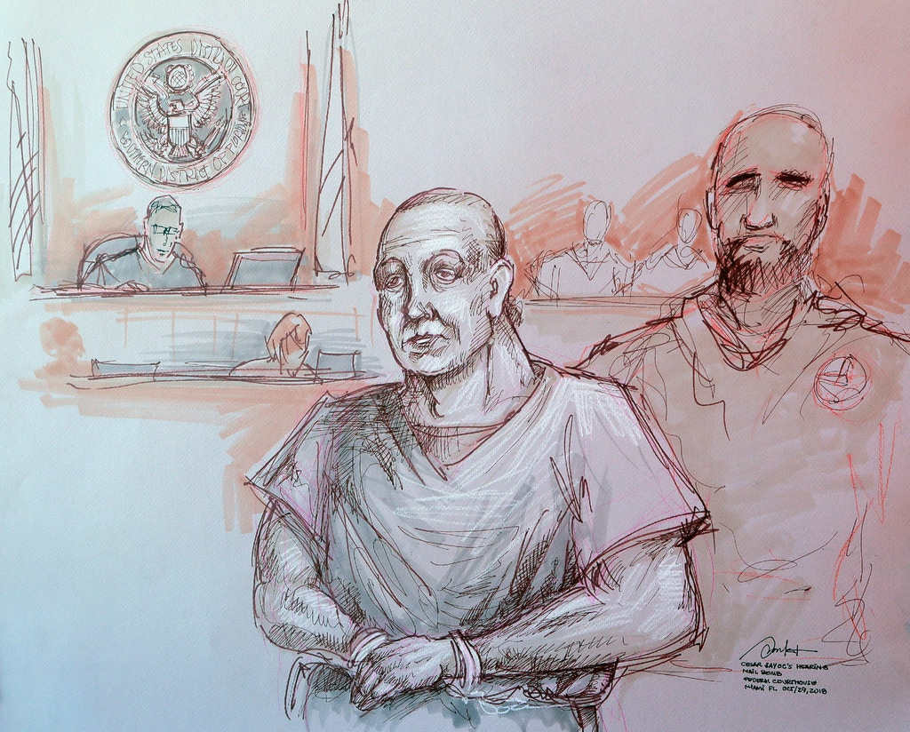 In this courtroom sketch, Cesar Sayoc, left, appears in federal court, Monday, Oct. 29, 2018, in Miami. Sayoc is accused of sending pipe bombs to prominent Democrats around the country. If foreign citizens had mailed pipe bombs to prominent Democrats, or massacred Jews in a synagogue, there's a good chance they would have been charged with terrorism. But that won't happen with either of the men charged in the recent wave of mail bombs and the Pittsburgh shootings. That's because there's no domestic terrorism law. (Daniel Pontet via AP)
