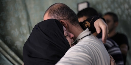 GAZA STRIP - AUGUST 20, 2014 - Palestinians mourn the bodies of Al Qassam general leaders' wife and son, Mohammed Al Deif, after a failed attempt of assassinating him in his home in Gaza yesterday. (Photo by Ibrahim Khader / Pacific Press/Sipa USA)