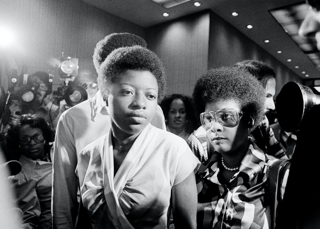 Joan Little and one of her defense attorneys, Kern Galloway, right, wait for an elevator in the lobby of the Wake County Courthouse in Raleigh, N.C., July 14, 1975, where she is on trial in the 1974 stabbing death of a jailer. (AP Photo/Harold Valentine)