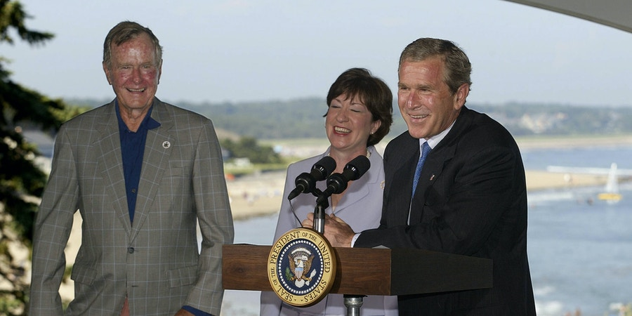 PROUTS NECK, UNITED STATES:  US President George W. Bush (R) and his father former president George Bush (L) attend a fundraiser for US Senator Susan Collins (C), R-ME, in Prouts Neck, Maine, 03 August 2002.  President Bush is vacationing at the Bush family home in Kennebunkport, Maine until 05 August.          AFP PHOTO  Luke FRAZZA (Photo credit should read LUKE FRAZZA/AFP/Getty Images)