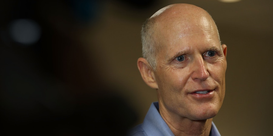 FORT LAUDERDALE, FL - AUGUST 22:  Florida Governor Rick Scott speaks to the media during a visit to a Florida Department of Transportation district office on August 22, 2018 in Fort Lauderdale, Florida. Scott visited the office to highlight $10.1 billion in transportation infrastructure spending included in his Securing Florida's Future budget. Republican Gov. Rick Scott is facing off against Democratic  Sen. Bill Nelson in Florida's U.S. Senate race.  (Photo by Joe Raedle/Getty Images)