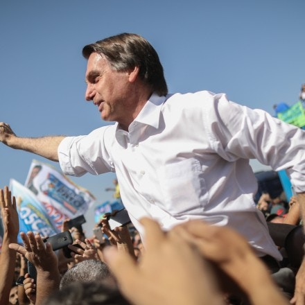 Jair Bolsonaro, presidential candidate for the Social Liberal Party (PSL), waves to supporters during a campaign rally in Taguatinga, Brazil, on Wednesday, Sept. 5, 2018. In polls which exclude former president Luiz Inacio Lula da Silva, Bolsonaro leads the pack ahead of Brazilian elections. Photographer: Andre Coelho/Bloomberg via Getty Images