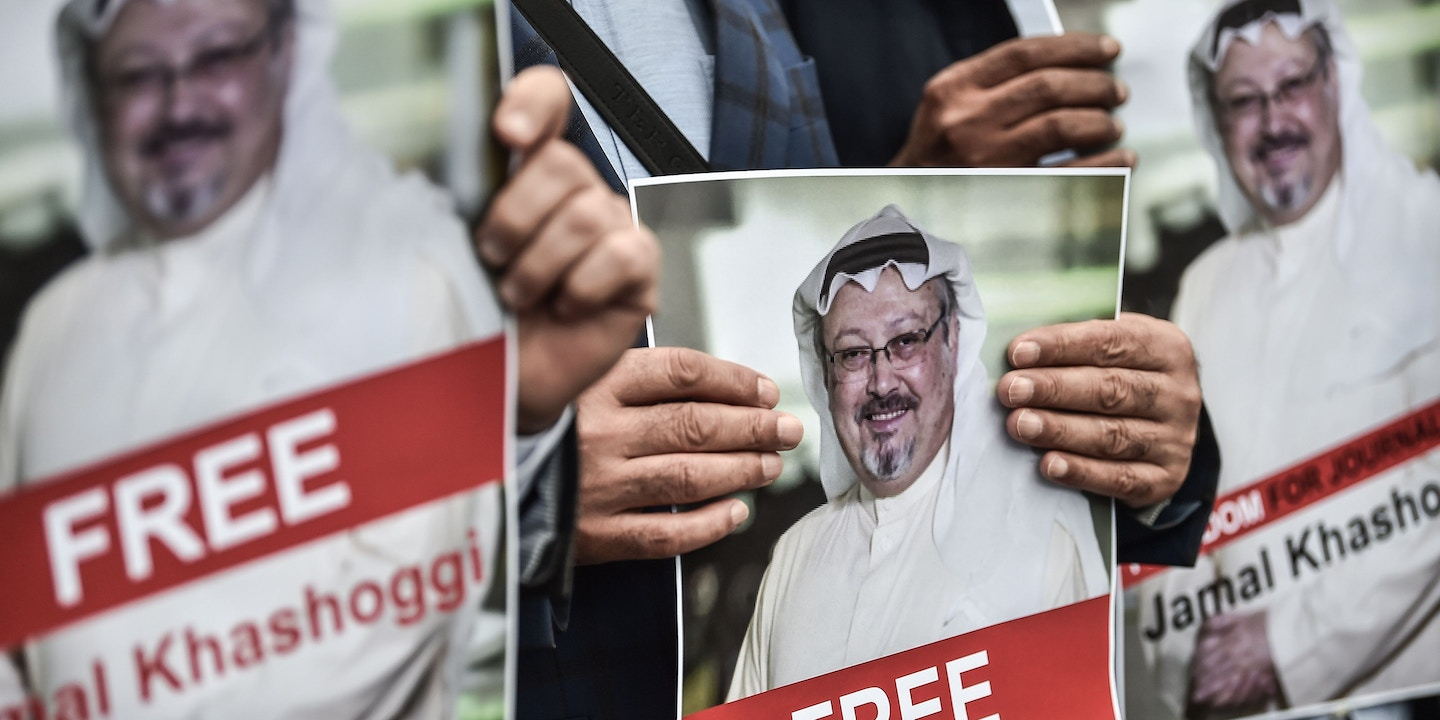 TOPSHOT - Protestors hold pictures of missing journalist Jamal Khashoggi during a demonstration in front of the Saudi Arabian consulate on October 8, 2018 in Istanbul. - Jamal Khashoggi, a veteran Saudi journalist who has been critical towards the Saudi government has gone missing after visiting the kingdom's consulate in Istanbul on October 2, 2018, the Washington Post reported. Turkey has sought permission to search Saudi Arabia's consulate in Istanbul after a prominent journalist from the kingdom went missing last week following a visit to the building, Turkish television reported on October 8. (Photo by OZAN KOSE / AFP) (Photo credit should read OZAN KOSE/AFP/Getty Images)