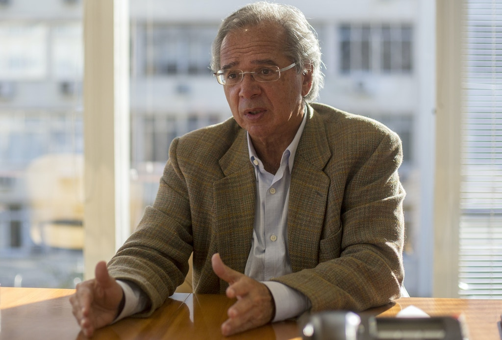 In this file photo taken on August 21, 2018, Brazilian economist of Brazil's right-wing presidential candidate for the Social Liberal Party (PSL) Jair Bolsonaro, Paulo Guedes, talks to the media in Rio de Janeiro, Brazil. - A deeply polarized Brazil stood at a political crossroads on October 8, 2018 as the bruising first round of the presidential election left voters with a stark choice in the run-off between far-right firebrand Jair Bolsonaro and leftist Fernando Haddad. Bolsonaro won 46 percent of the vote to Haddad's 29 percent, according to official results. (Photo by Daniel RAMALHO / AFP)        (Photo credit should read DANIEL RAMALHO/AFP/Getty Images)