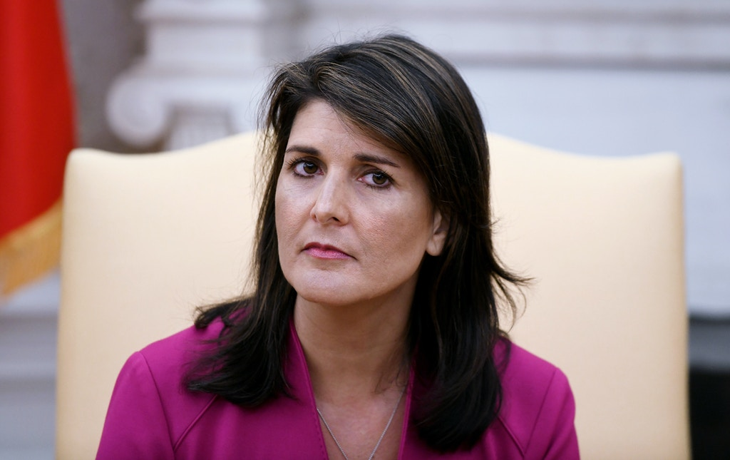 "Nikki Haley, the United States Ambassador to the United Nations looks on during a meeting with US President Donald Trump speaks in the Oval office of the White House October 9, 2018 in Washington, DC. - Nikki Haley resigned Tuesday as the US ambassador to the United Nations, in the latest departure from President Donald Trump's national security team. Meeting Haley in the Oval Office, Trump said that Haley had done a ""fantastic job"" and would leave at the end of the year. (Photo by Olivier Douliery / AFP)        (Photo credit should read OLIVIER DOULIERY/AFP/Getty Images)"