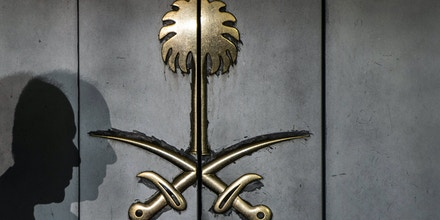 TOPSHOT - The shadow of a security guard is seen on the entrance door of the Saudi Arabia's consulate in Istanbul, on October 12, 2018. - A Saudi delegation has arrived in Turkey for talks on missing journalist Jamal Khashoggi, officials said on October 12, with Riyadh and Ankara sharply at odds over how he disappeared last week from the kingdom's Istanbul consulate. (Photo by Yasin AKGUL / AFP)        (Photo credit should read YASIN AKGUL/AFP/Getty Images)