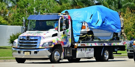 MIRAMAR, FL - OCTOBER 26:  A van covered in blue tarp is towed by FBI investigators to FBI Miramar Headquarters on October 26, 2018 in Miramar, Florida. The van belongs to Cesar Sayoc, 56, the suspect arrested in connection to the string of pipe bombs mailed to prominent democrats across the country. The van was towed from an AutoZone in Plantation, Florida. (Photo by Johnny Louis/Getty Images)