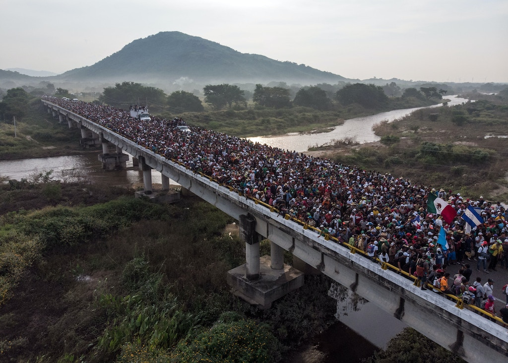 Aerial view of Honduran migrants heading in a caravan to the US, as the leave Arriaga on their way to San Pedro Tapanatepec, in southern Mexico on October 27, 2018. - Mexico on Friday announced it will offer Central American migrants medical care, education for their children and access to temporary jobs as long as they stay in two southern states. (Photo by Guillermo Arias / AFP)        (Photo credit should read GUILLERMO ARIAS/AFP/Getty Images)