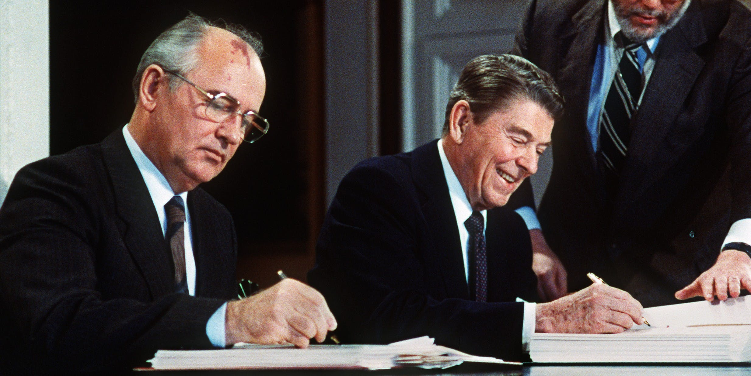Soviet leader Mikhail Gorbatchev (L) and US President Ronald Reagan sign 08 December 1987 at the Washington summit a treaty eliminating US and Soviet intermediate-range and shorter-range nuke missiles.   AFP PHOTO / AFP / -        (Photo credit should read -/AFP/Getty Images)
