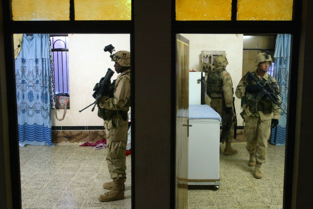 TALLAFAR, IRAQ - OCTOBER 30:  U.S. Army soldiers from the 101st Airborne regiment search a home  October 30, 2003 in Tal Afar, Iraq. (Photo by Joe Raedle/Getty Images)