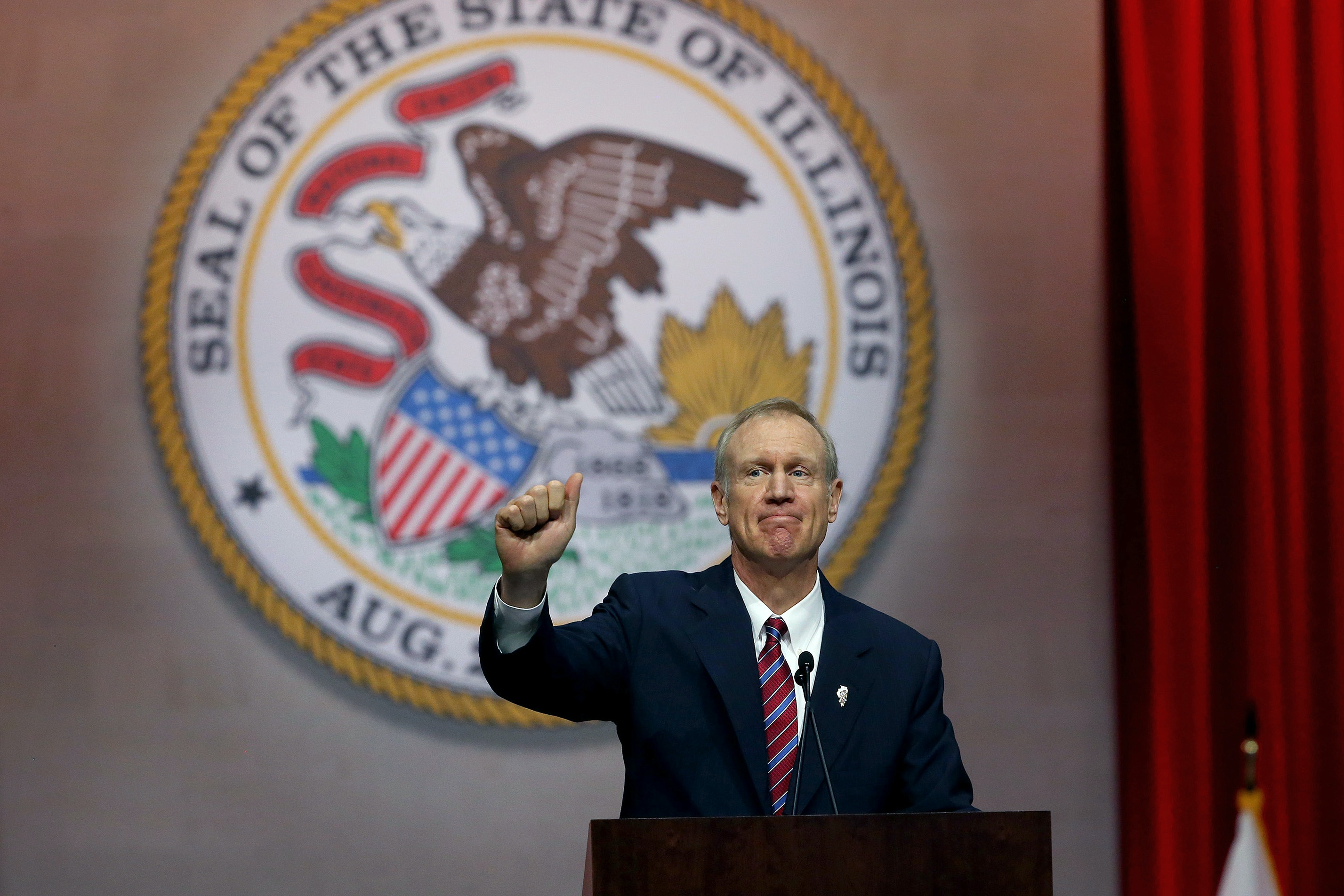 Gov. Bruce Rauner gives a thumbs up after giving his first speech as governor on Monday Jan. 12, 2015 at the Prairie Capital Convention Center in Springfield, Ill. (Nancy Stone/Chicago Tribune/TNS via Getty Images)