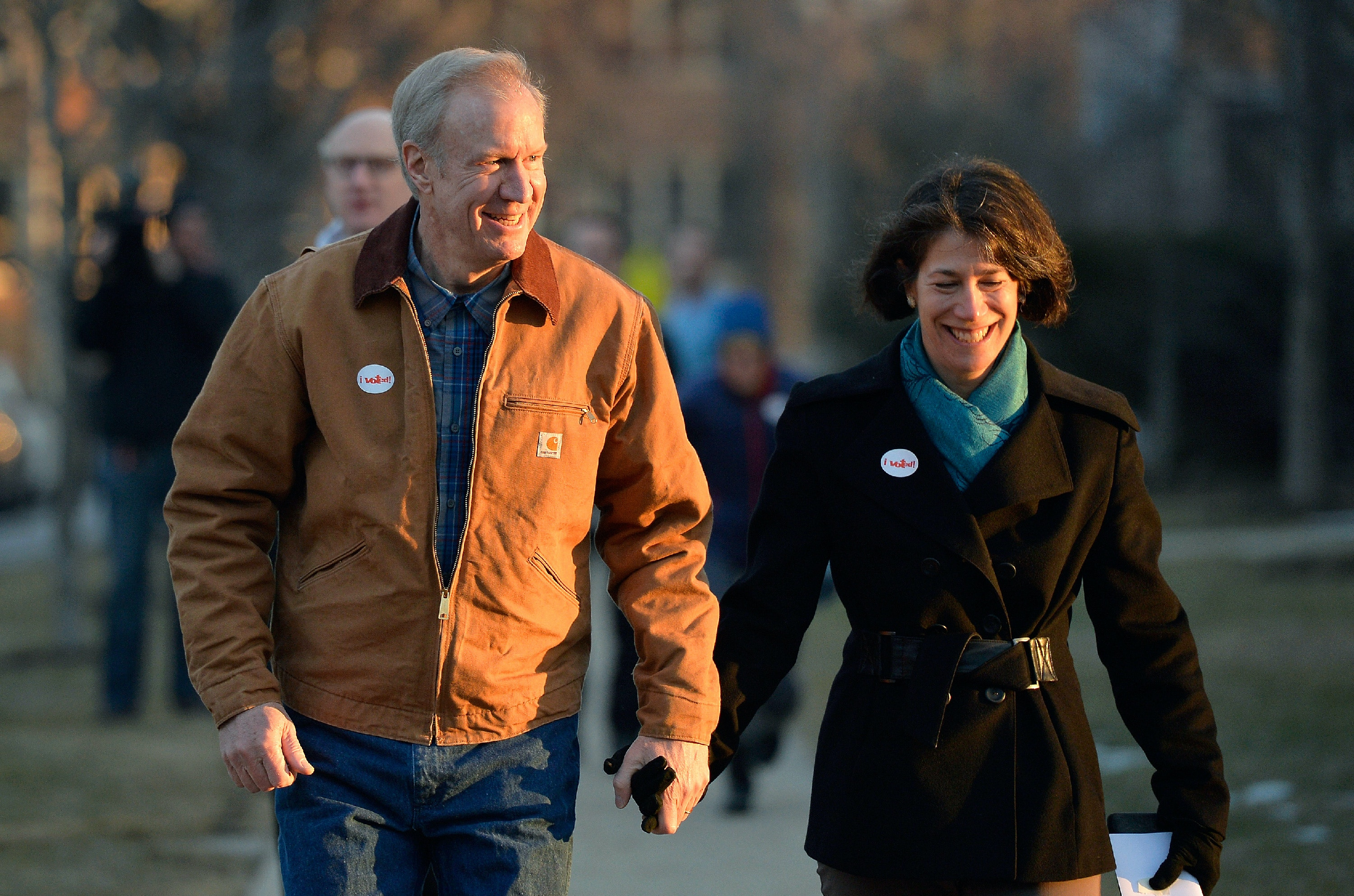 WINNETKA, IL - MARCH 18: Republican Gubernatorial Candidate Bruce Rauner (L) and his wife Diana walk home after voting in the Illinois primary election on March 18, 2014 in Winnetka, Illinois. Rauner, a private equity manager, faces off against State Senator Bill Brady, State Treasurer Dan Rutherford and State Senator Kirk Dillard in the Republican primary.  (Photo by Brian Kersey/Getty Images)