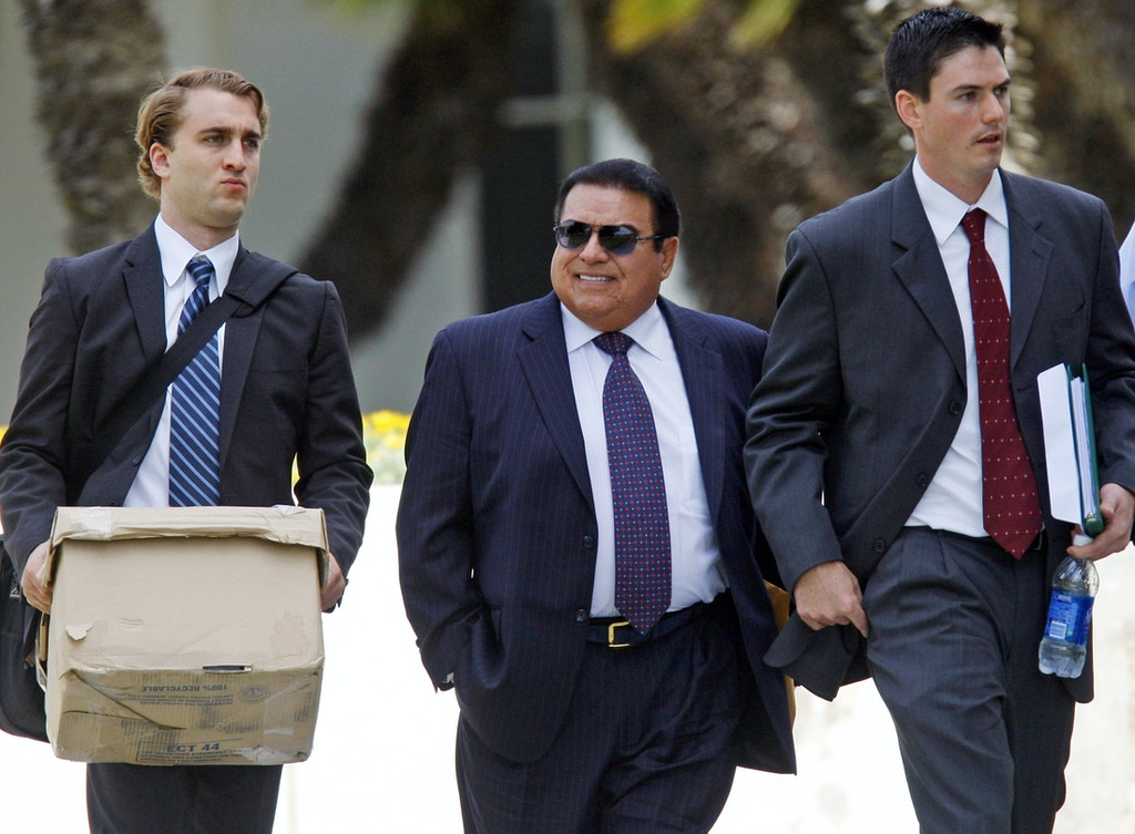 Alfred R. Villalobos, center, exits LA County Superior Court, West District in Santa Monica after a judge ruled the receivership will stay in order and his assests will remain frozen as ordered by the court. Villalobos contends that nothing about his commissions was hidden from the California Public Employees' Retirement System, a claim that is part of his aggressive defense of a state Attorney General's civil lawsuit against him.  (Photo by Allen J. Schaben/Los Angeles Times via Getty Images)