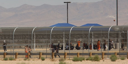 Imprisoned immigrants are seen at the US Immigration and Customs Enforcement (ICE) Adelanto Detention Facility near the border of the