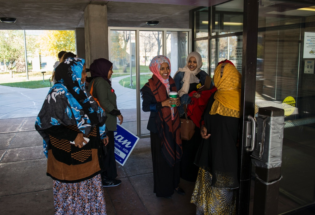 Ilhan Omar(2nd-L), candidate for State Representative for District 60B in Minnesota, campaigns on on election day, November 8, 2016 in Minneapolis, Minnesota. Omar, a refugee from Somalia, would be the first Somali-American Muslim woman if elected. / AFP / STEPHEN MATUREN        (Photo credit should read STEPHEN MATUREN/AFP/Getty Images)