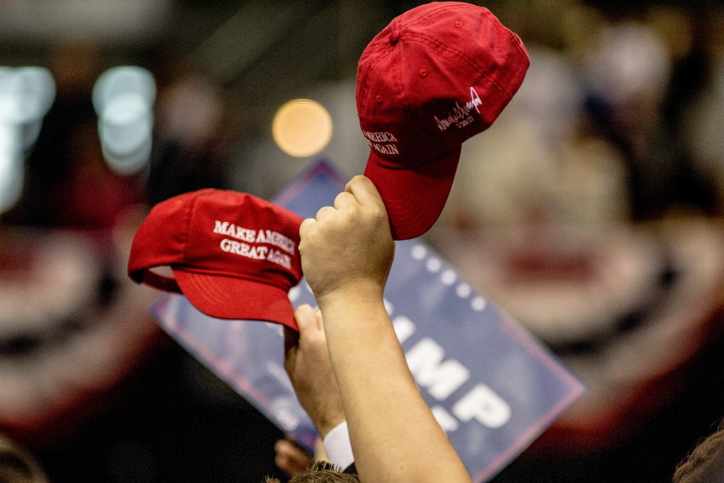 NASHVILLE, TN - MARCH 15: Supporters hold up their hats during a rally held by President Trump on March 15, 2017 in Nashville, Tennessee. During his speech President Trump promised to repeal and replace Obamacare and also criticized the decision by a federal judge in Hawaii that halted the latest version of the travel ban. (Photo by Andrea Morales/Getty Images)