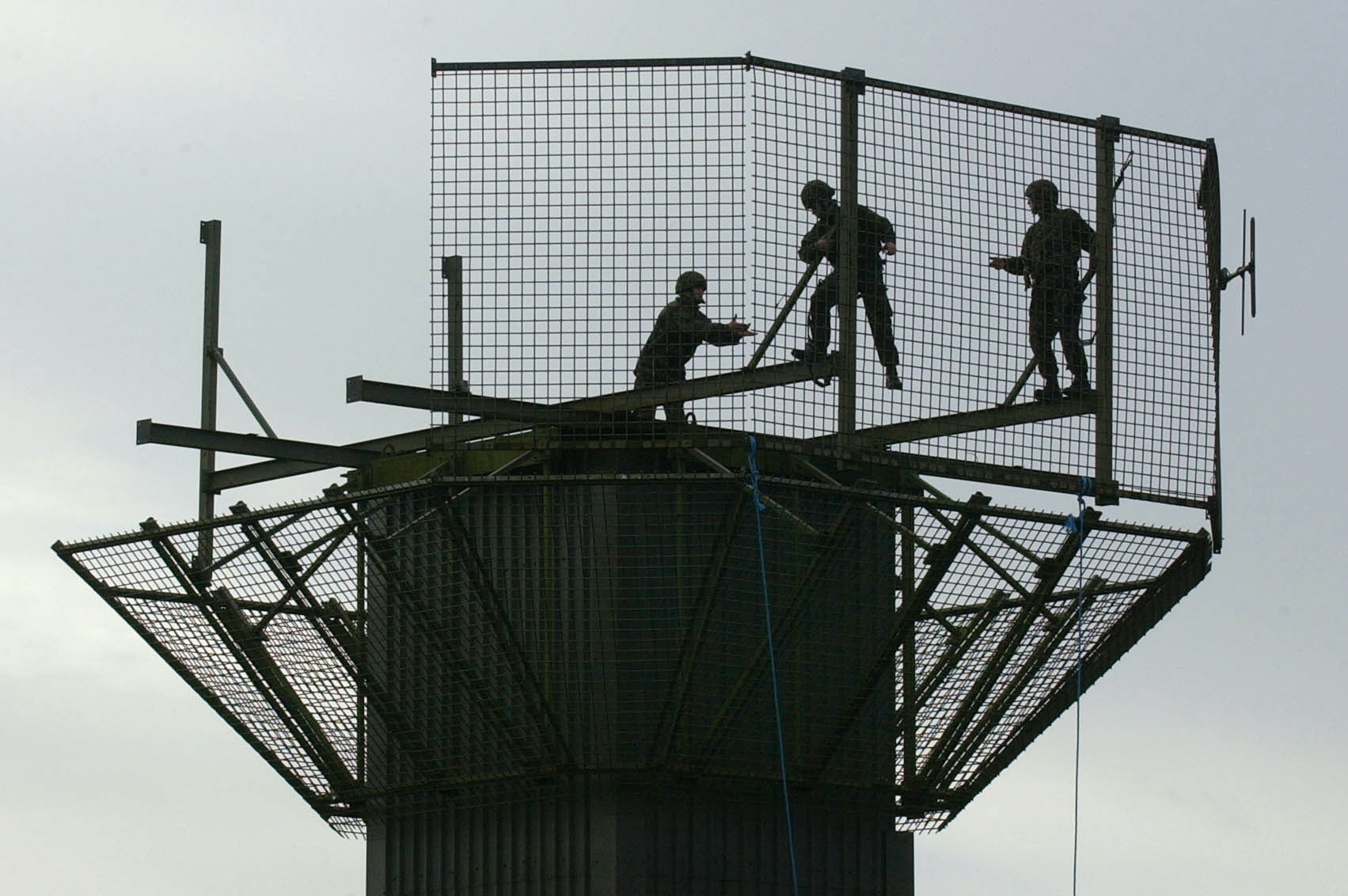 British Army Engineers dismantle the Watch Tower at Newtonhamilton, Northern Ireland after the armoured Sangar was uprooted by crane. The British government has started dismantling military watch towers across Northern Ireland.  *... in response to the announcement by the IRA that they have begun to decommission their weapons.   (Photo by John Giles - PA Images/PA Images via Getty Images)