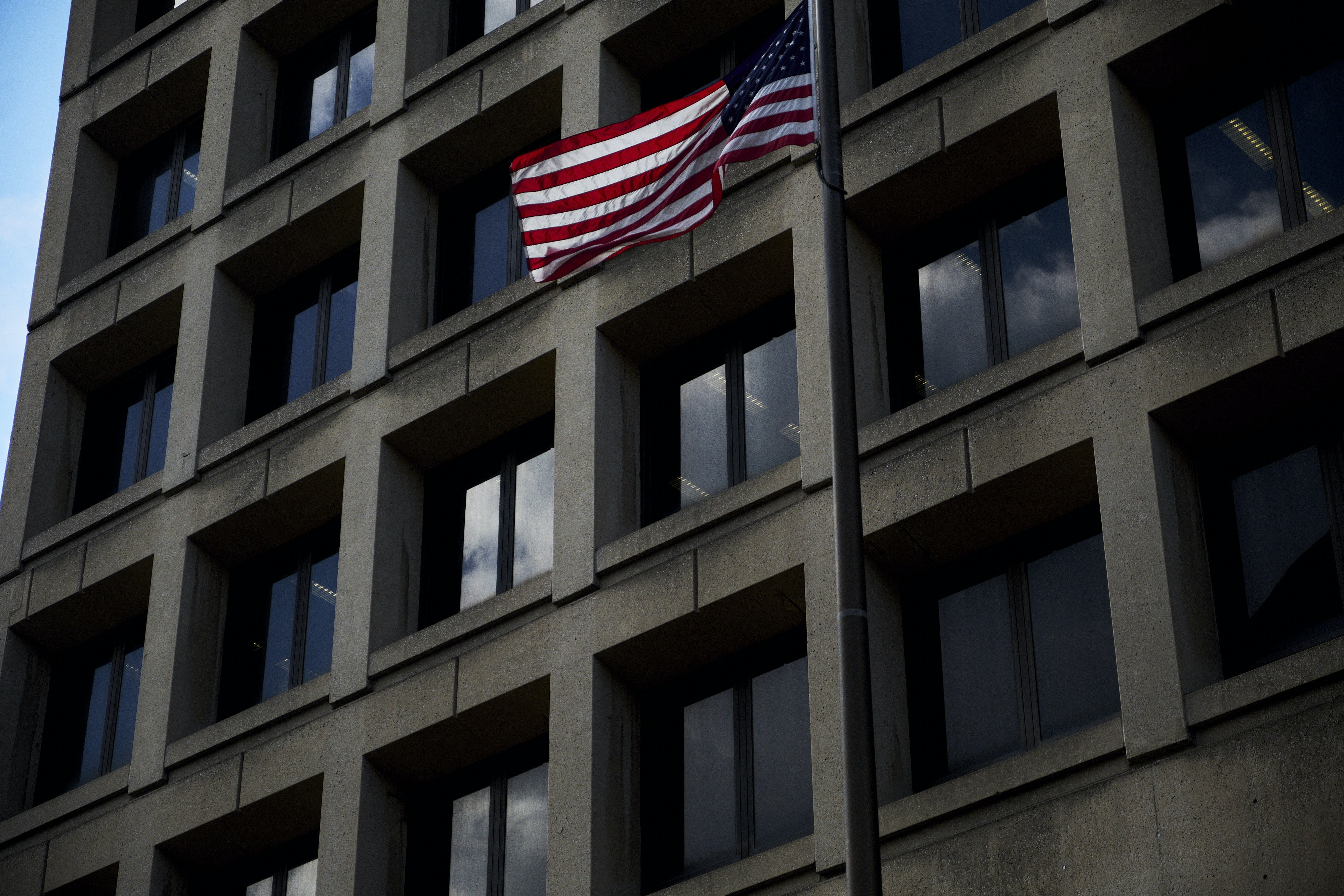 An American flag flies outside the Federal Bureau of Investigation (FBI) headquarters in Washington, D.C., U.S., on Friday, Feb. 2, 2018. FBI and Justice Department officials got a warrant to spy on a Trump campaign associate by misleading a surveillance court judge, House Republicans contend in a newly released memo that Democrats have dismissed as a contrived account intended to protect the president. Photographer: T.J. Kirkpatrick/Bloomberg via Getty Images