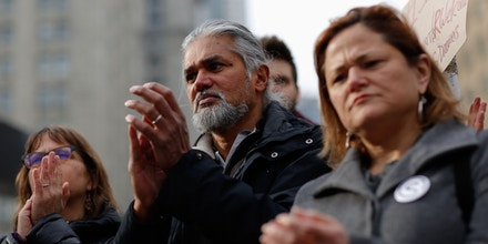 Immigrant rights activist Ravi Ragbir and his wife Amy Gottlieb (L) attend a Rally a day after he granted temporary stay of deportation in Foley Square on February 10, 2018 in New York . / AFP PHOTO / Kena Betancur        (Photo credit should read KENA BETANCUR/AFP/Getty Images)