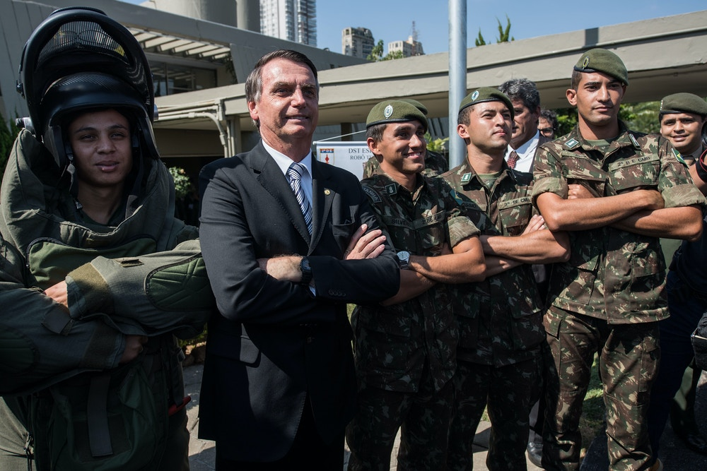 Brazilian congressman and presidential canditate for the next election, Jair Bolsonaro (R), poses for pictures with militaries during an military event in Sao Paulo, Brazil on May 3, 2018. (Photo by Nelson ALMEIDA / AFP)        (Photo credit should read NELSON ALMEIDA/AFP/Getty Images)