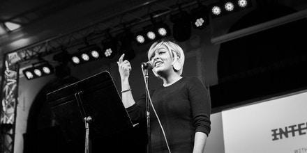Eve Ewing performs a poem during a live taping of the Intercepted podcast at the Logan Square Auditorium in Chicago, on October 9th, 2018.