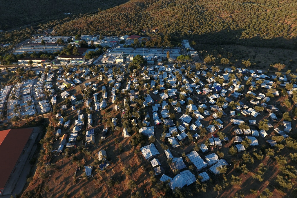 A view of the Moria camp for refugees and migrants and a makeshift camp set next to Moria, on the island of Lesbos, Greece, Sept. 19, 2018.
