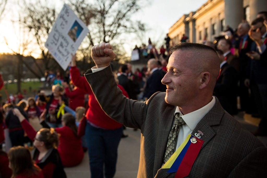 Democratic state Senator Ricahrd Ojeda cheers on a crowd of striking school workers on the steps of the West Virginia capitol in Charlestown last Tuesday. Ojeda has become a champion of the strike, making frequent speeches in support of teachers demands for higher raises and better health benefits.