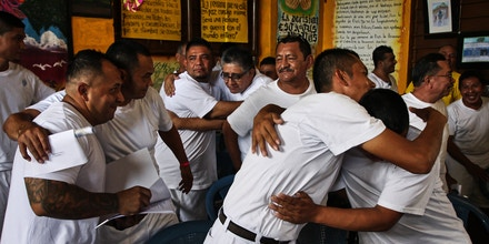 A group of inmates inside San Vicente prison celebrate that they complete the program Second Chance, that promotes peace culture within the former gang members.