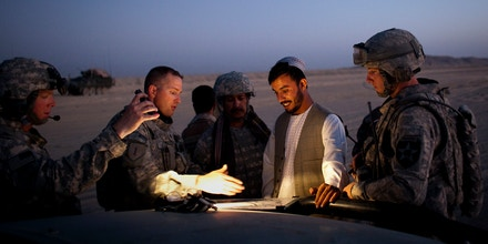 U.S. Lt. Col. William Clark, second from left, talks with Gen. Abdul Raziq during a joint patrol along the border with Pakistan, on the outskirts of Spin Boldak, Afghanistan, on Aug. 7, 2009.