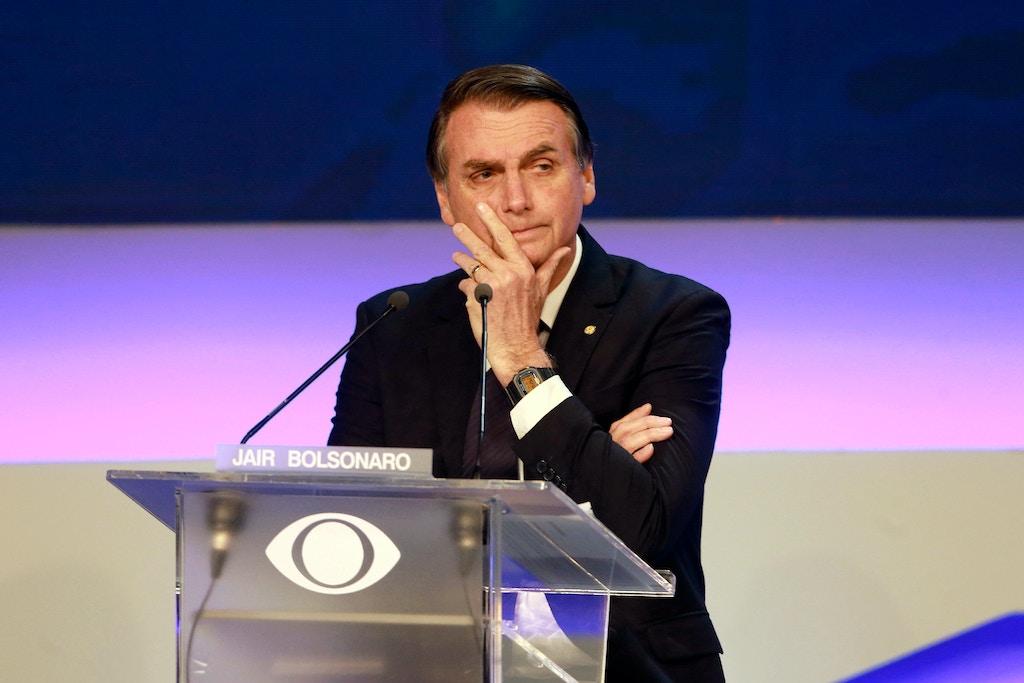 O candidato à Presidência Jair Bolsonaro no primeiro debate presidencial à frente das eleições gerais de 7 de outubro, na rede Bandeirantes em São Paulo, Brasil, em 9 de agosto de 2018.