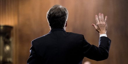 UNITED STATES - SEPTEMBER 27: Judge Brett Kavanaugh is sworn in before testifying during the Senate Judiciary Committee hearing on his nomination be an associate justice of the Supreme Court of the United States, focusing on allegations of sexual assault by Kavanaugh against Christine Blasey Ford in the early 1980s. (Photo By Tom Williams/CQ Roll Call/POOL) | usage worldwide Photo by: Tom Williams/picture-alliance/dpa/AP Images