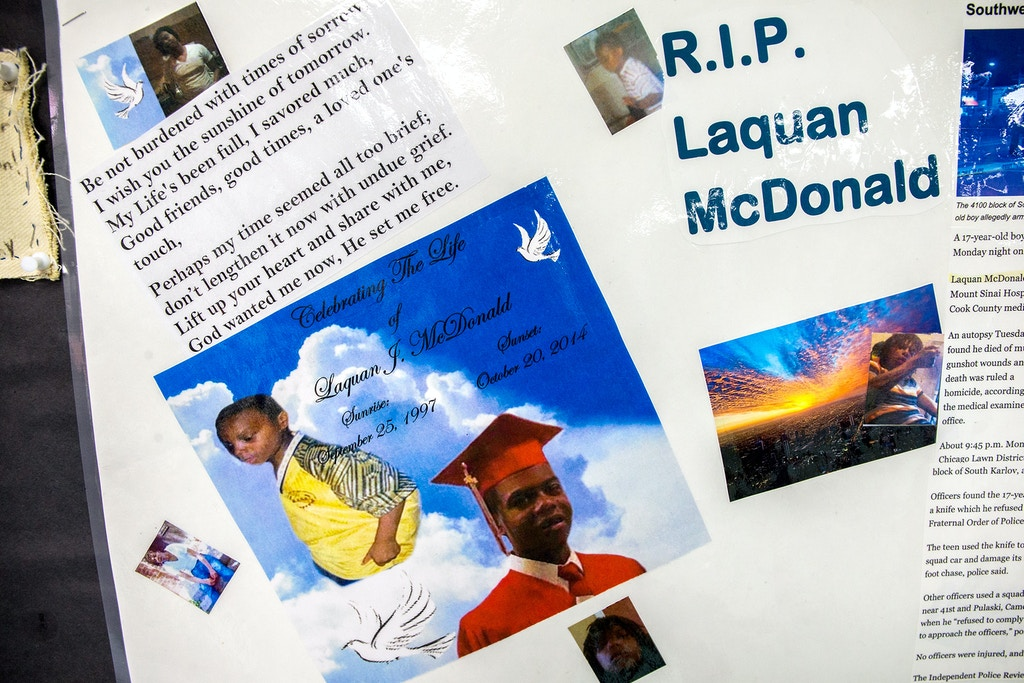 A memorial to 17-year-old Laquan McDonald and other victims of violence at the Sullivan House Alternative High School in Chicago is seen on April 17, 2015. McDonald was shot 16 times by Chicago police Officer Jason Van Dyke in October 2014. A judge has ordered the video of the shooting to be made public. (Zbigniew Bzdak/Chicago Tribune/TNS via Getty Images)