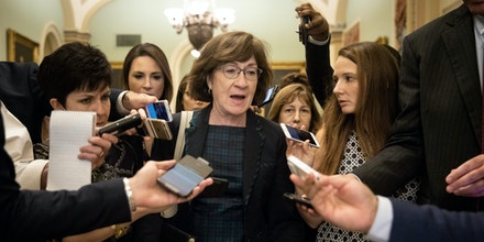 WASHINGTON, DC - SEPTEMBER 26: Sen. Susan Collins (R-ME) is surrounded by reporters following a closed-door meeting of Senate Republicans on Capitol Hill, September 26, 2018 in Washington, DC. Christine Blasey Ford, who has accused Kavanaugh of sexual assault, has agreed to testify before the Senate Judiciary Committee on Thursday. (Photo by Drew Angerer/Getty Images)