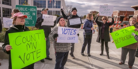 Porter County residents converge on the Porter County Administration Center to voice their protest against the vote counting of Tuesday's election.