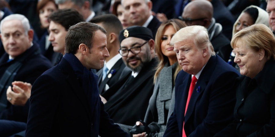 French President Emmanuel Macron (front R) walks past German Chancellor Angela Merkel (R), US President Donald Trump (2nd R), US First Lady Melania Trump (3rd R)  and Morocco's King Mohammed VI (rear C) as they attend a ceremony at the Arc de Triomphe in Paris on November 11, 2018 as part of commemorations marking the 100th anniversary of the 11 November 1918 armistice, ending World War I. (Photo by BENOIT TESSIER / POOL / AFP)        (Photo credit should read BENOIT TESSIER/AFP/Getty Images)
