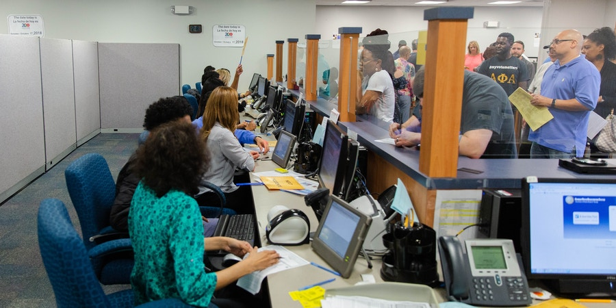 Voters arrive for early voting at the Gwinnett County (Ga.) Voter Registrations and Elections Office in Lawrenceville, Ga., on Wednesday, Oct. 17, 2018. Here, they are checked for ID and other paperwork before voting. Photo by Kevin D. Liles for The Intercept
