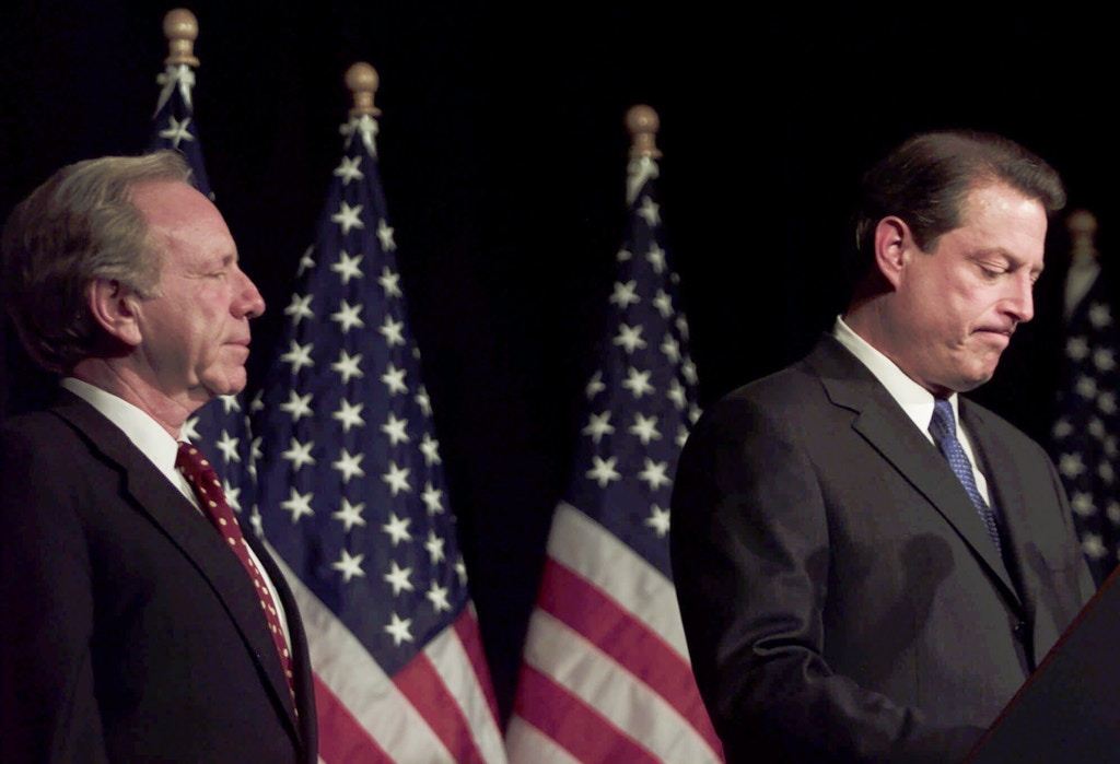 Democratic presidential candidate Vice President Al Gore, right,   makes a statement on the recounting of votes in the state of Florida, while his running mate Sen. Joe Lieberman, D-Conn., stands by Wednesday, Nov. 8, 2000, in Nashville, Tenn. (AP Photo/Hillery Smith Garrison)