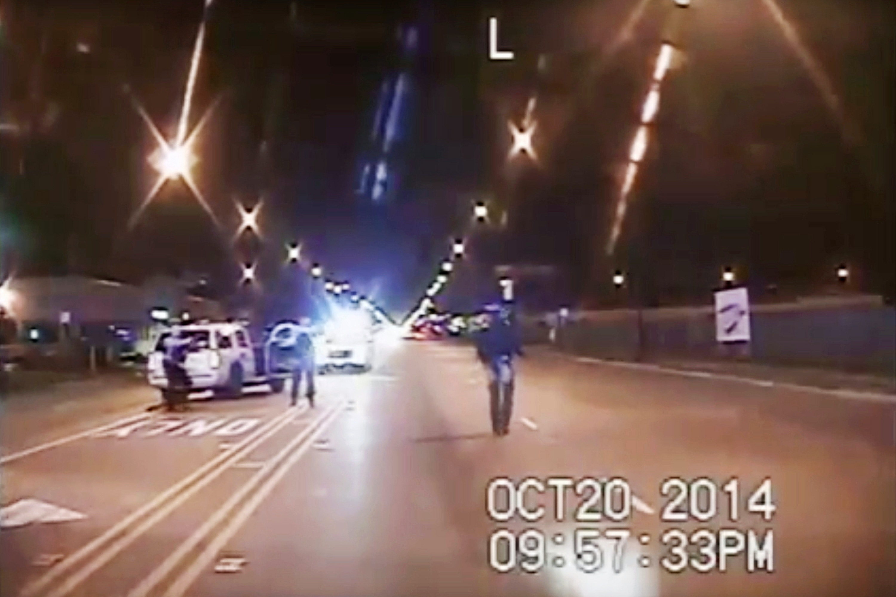 "FILE - In this Oct. 20, 2014 file image taken from dash-cam video provided by the Chicago Police Department, Laquan McDonald, right, walks down the street moments before being fatally shot by Chicago Police officer Jason Van Dyke in Chicago. After days of prosecutors making their case to jurors that Van Dyke committed first-degree murder when he shot the black teenager 16 times, Van Dyke's attorneys are presenting their own evidence. And almost immediately their strategy became clear: The teenager was a violent, dangerous, knife-wielding suspect ""on ""a rampage"" that Van Dyke was forced to kill. (Chicago Police Department via AP, File)"