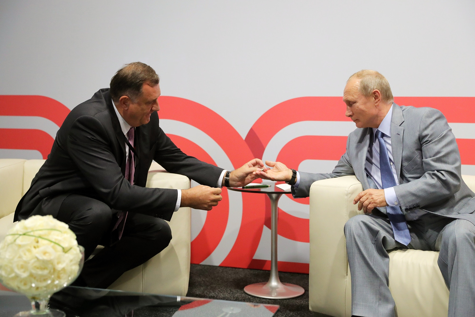 5651852 30.09.2018 September 30, 2018. Russian President Vladimir Putin and President of the Republika Srpska entity of Bosnia and Herzegovina Milorad Dodik, left, during their meeting at Sochi Autodrom. Mikhael Klimentyev / Sputnik  via AP